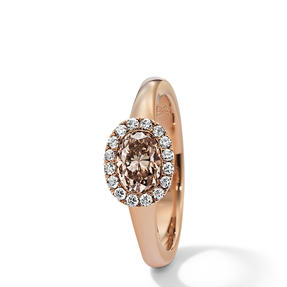 Ring in 18k rose gold set with Orange Brown and colourless diamonds. Available in different sizes.