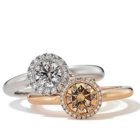 Rings in 18k white gold and rose gold set with colourless and Orange Brown diamonds. Available in different sizes.