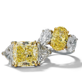 Rings in platinum set with Fancy Intense Yellow and colourless diamonds. Available in different sizes.