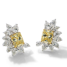 Earrings in 18k white gold set with Fancy Yellow and colourless diamonds.