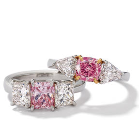 Rings in platinum set with Fancy Intense Pink and colourless diamonds. Available in different sizes.