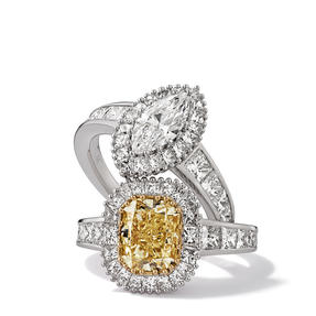 Rings in 18K white gold set with Fancy Yellow and colourless diamonds. Available in different sizes.