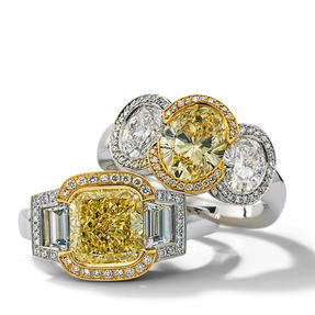 Rings in platinum and 18k yellow gold set with Fancy Yellow and colourless diamonds. Available in different sizes.