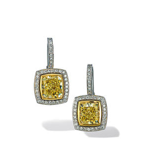 Earrings in 18k white gold and yellow gold set with Fancy Yellow and colourless diamonds.
