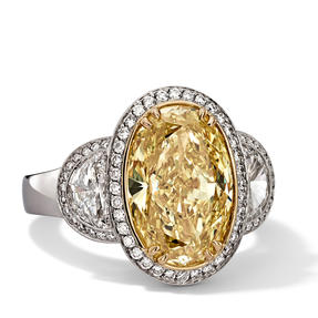 Ring in 18k white gold and yellow gold set with Fancy Intense Yellow and colourless diamonds. Available in different sizes.