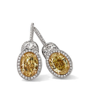 Earrings in 18k white gold and yellow gold set with Fancy Intense Yellow and colourless diamonds.