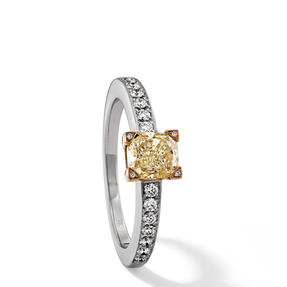 Ring in 18k white gold and yellow gold set with Fancy Yellow and colourless diamonds. Available in different sizes.