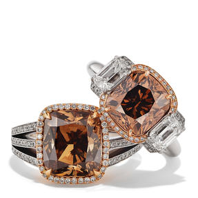 Rings in 18k white gold and rose gold set with Orange Brown diamond and colourless diamonds. Available in different sizes.